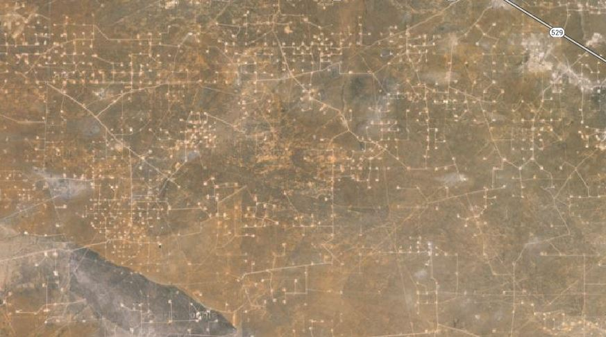 Google Map satellite view NE of Carlsbad, NM. Every little dot is the site of an oil rig.